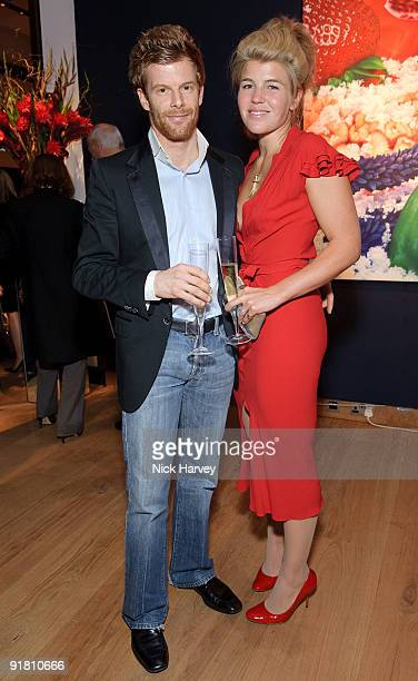 Tom Aiken and Amber Aiken attend reception hosted by Graff held in aid of FACET at Christie's King Street on October 12 2009 in London England