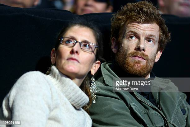 Tom Aikens and Justine DobbsHigginson attend the men's singles semifinal match between Andy Murray of Great Britain and Roger Federer of Switzerland...