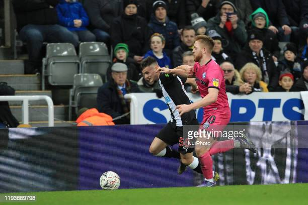 Tom Allan of Newcastle United battles with Jimmy Ryan of Rochdale during the FA Cup match between Newcastle United and Rochdale at St James's Park...