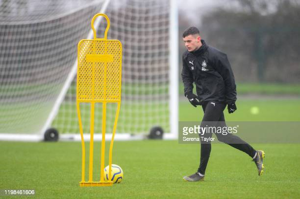 Tom Allan runs with the ball in a drill during the Newcastle United Training Session at the Newcastle United Training Centre on January 09 2020 in...