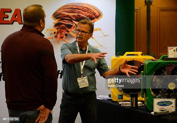 Tom Allen Green Tech Heat Solutions right talks James Hockenyos Sentinel Insect Control Lab Springfield Illinois at a bedbug trade show during the...
