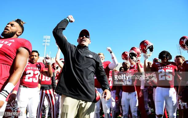 Tom Allen head coach of the Indiana Hoosiers and and the Indiana Hoosiers celebrate after defeating the Rutgers Scarlet Knights 35-0 at Memorial...