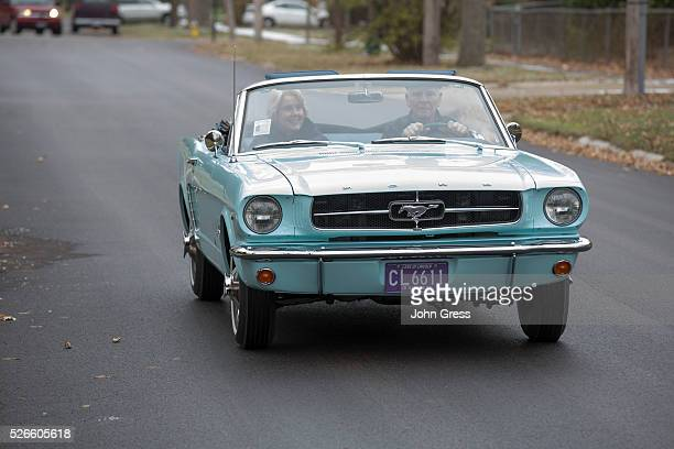 Tom and Gail Wise ride in her Skylight Blue 1964 1/2 Ford Mustang convertible in Park Ridge Illinois November 26th 2013 Gail Wise then using her...