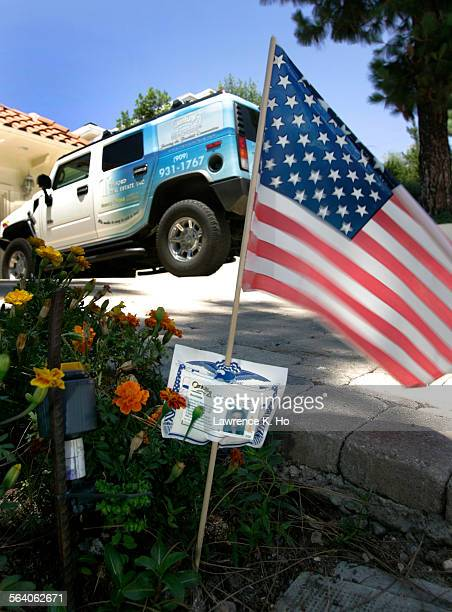 Tom and Nancy Telford real estate agents gave out flags with their business cards attached to local homeowners but is caught in a dispute with...