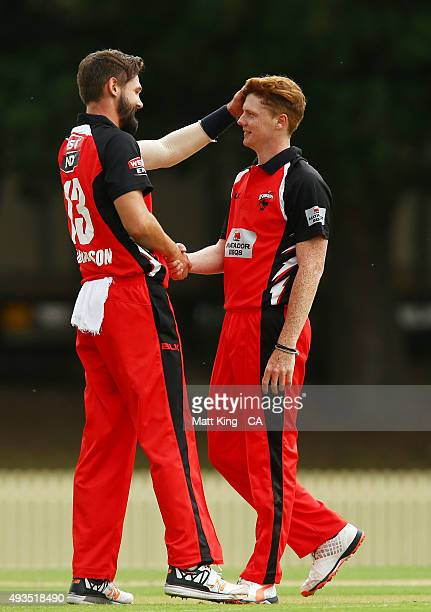Tom Andrews of the Redbacks celebrates with Kane Richardson of the Redbacks after taking the wicket of Hilton Cartwright of Cricket Australia via...