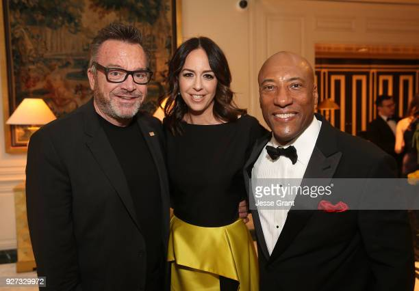 Tom Arnold Ashley Groussman and Byron Allen attend Byron Allen's Oscar Gala Viewing Party to Support The Children's Hospital Los Angeles at the...
