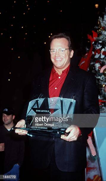 Tom Arnold at the Hollywood Christmas Parade November 30 1997 in Hollywood Ca Beverly Hills plastic surgeon Dr Nicholas Chugay claims to be able to...