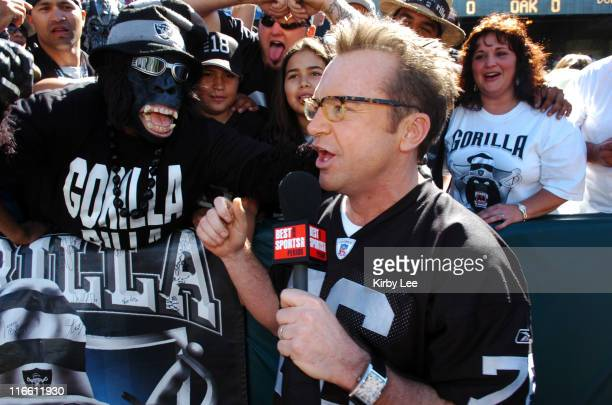 Tom Arnold of the 'Best Damn Sports Show Period' interviews Oakland Raider fans in the 'Black Hole' before game against the Dallas Cowboys at McAfee...