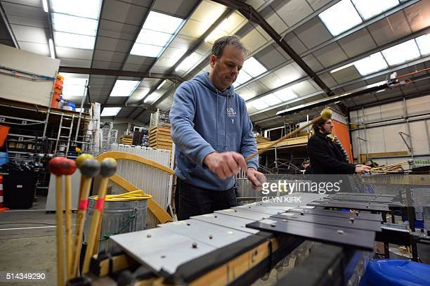 Tom Arnold of The Lost Found Orchestra plays the Glockenspiel during rehearsals for their forthcoming european tour in Henfield southern England on...