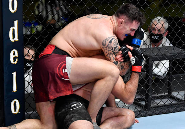 Tom Aspinall of England secures a rear choke submission against Andrei Arlovski of Belarus in a heavyweight bout during the UFC Fight Night event at...