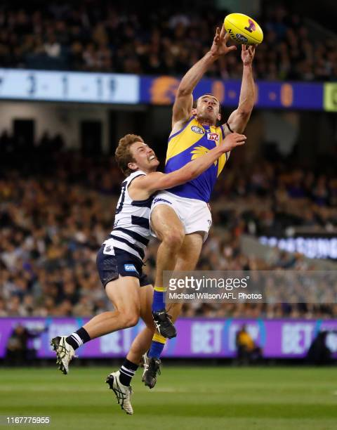 Tom Atkins of the Cats and Shannon Hurn of the Eagles compete for the ball during the 2019 AFL First Semi Final match between the Geelong Cats and...