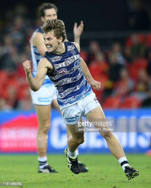 Tom Atkins of the Cats celebrates his goal during the round 10 AFL match between the Gold Coast Suns and the Geelong Cats at Metricon Stadium on May...