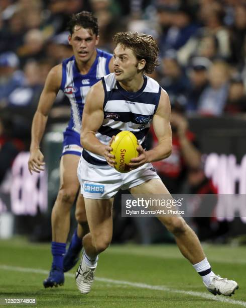 Tom Atkins of the Cats in action during the 2021 AFL Round 05 match between the Geelong Cats and the North Melbourne Kangaroos at GMHBA Stadium on...