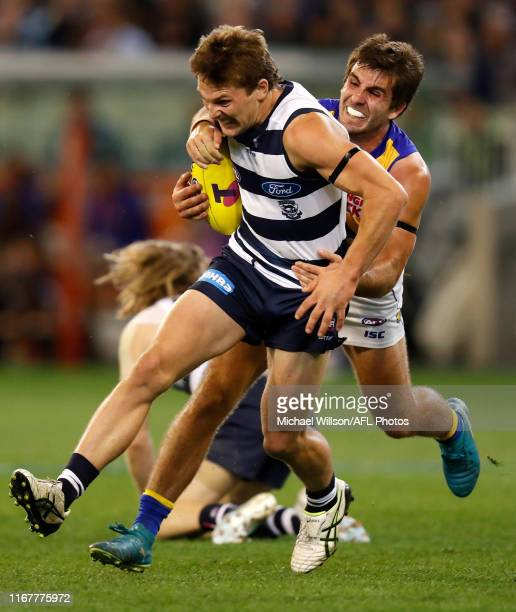 Tom Atkins of the Cats is tackled by Andrew Gaff of the Eagles during the 2019 AFL First Semi Final match between the Geelong Cats and the West Coast...