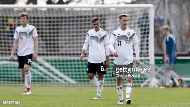 Tom Baak Atakan Akkaynak and Sam Francis Schreck of Germany look dejected after the fight goal of Norway during the UEFA Under19 European...