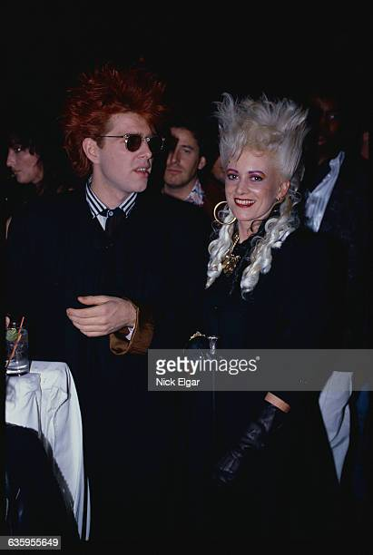 Tom Bailey and Alannah Currie of the Thompson Twins sit together
