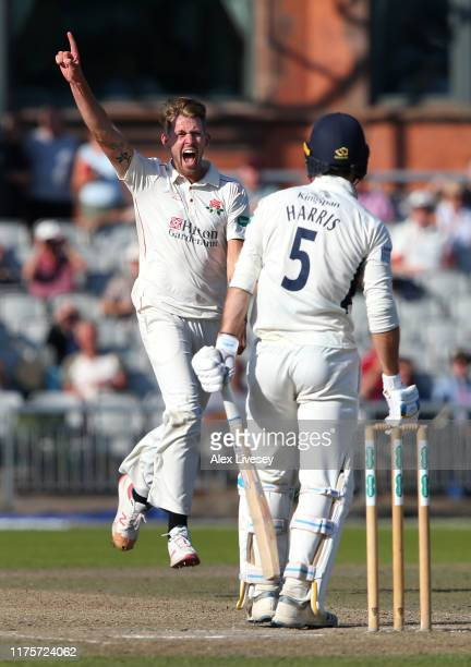 Tom Bailey of Lancashire celebrates after taking the wicket of James Harris of Middlesex during the Specsavers County Championship Division Two match...