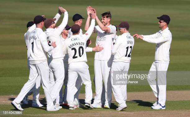 Tom Bailey of Lancashire celebrates with his team mates after dismissing Jordan Cox of Kent for a duck during Day Two of the LV= Insurance County...