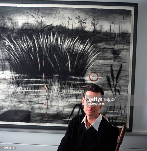"""Tom Baker, a member of the ICA's """"New Group"""" of art collectors, in his living room, in front of artist William Kentridge's """"Reeds,"""" an etching with..."""