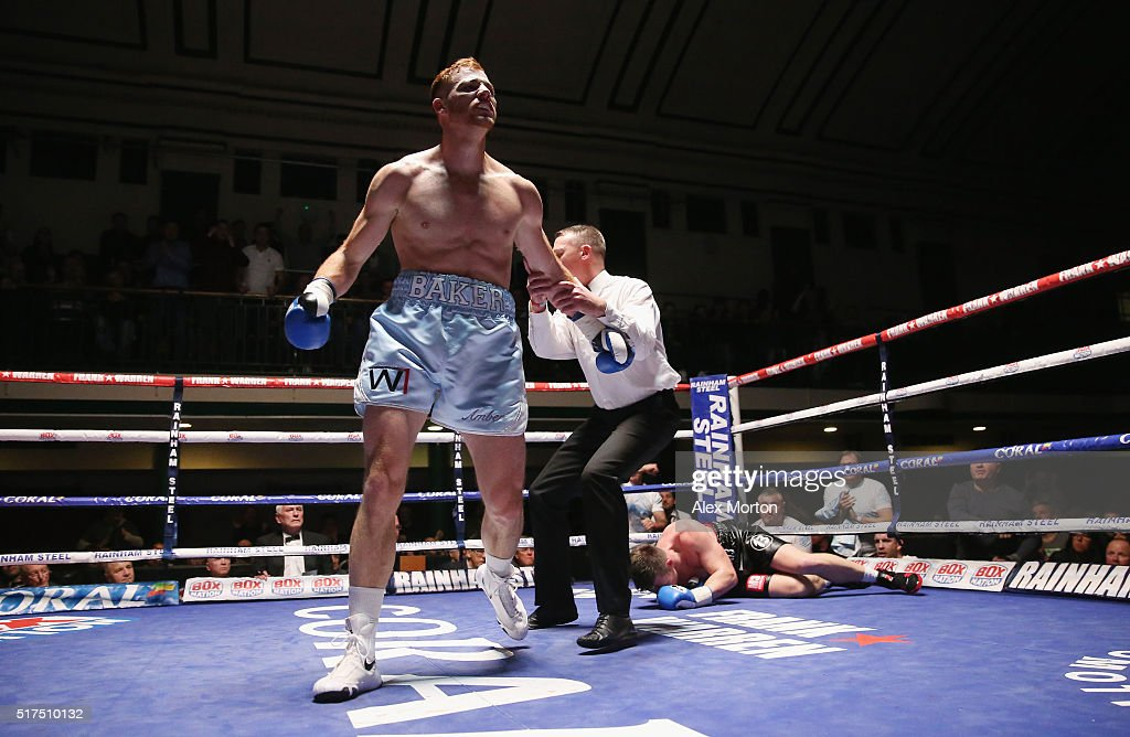 Tom Baker (left) after knocking down Jack Morris (right on floor) during the English Light-Heavyweight Championship fight between Tom Baker and Jack Morris at York Hall on March 25, 2016 in London, England.
