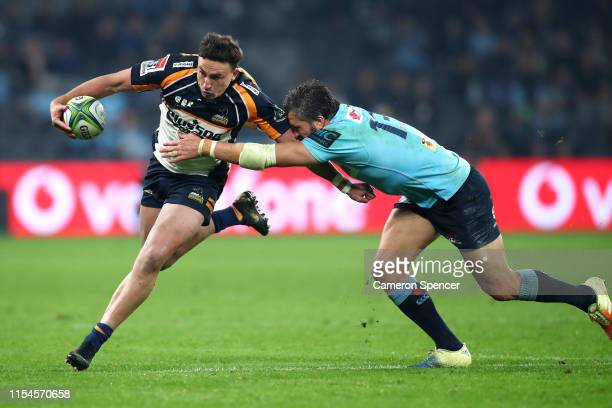 Tom Banks of the Brumbies makes a break during the round 17 Super Rugby match between the Waratahs and the Brumbies at Bankwest Stadium on June 08...