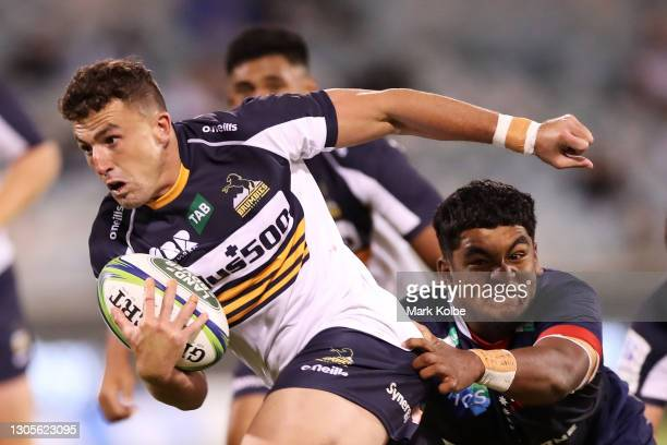 Tom Banks of the Brumbies makes a break during the round three Super RugbyAU match between the Melbourne Rebels and the Brumbies at GIO Stadium, on...