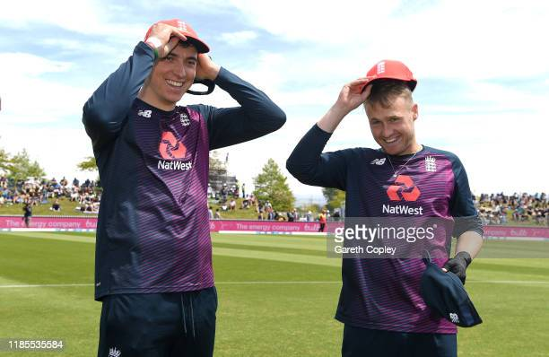 Tom Banton and Matt Parkinson of England are presented with their IT20 caps ahead of game three of the Twenty20 International series between New...