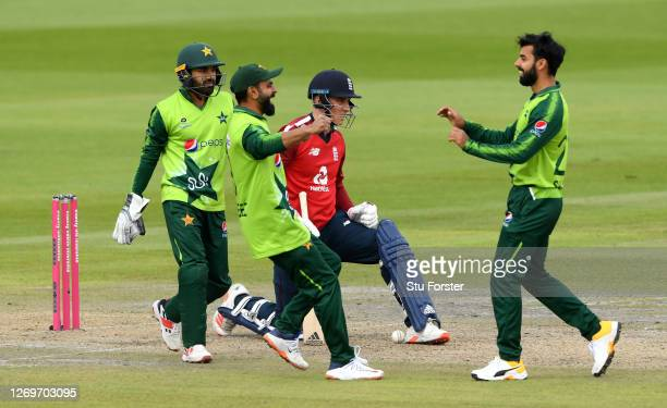 Tom Banton of England reacts as Shadab Khan of Pakistan celebrates his wicket with Mohammad Hafeez during the 2nd Vitality International Twenty20...