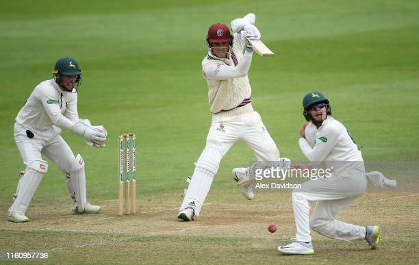 Tom Banton of Somerset bats as Liam PattersonWhite of Nottinghamshire gets out the way and Tom Moores of Nottinghamshire looks on during Day Three of...