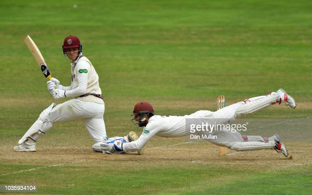 Tom Banton of Somerset is caught by Ben Foakes of Surrey during day two of the Specsavers County Championship Division One match between Somerset and...