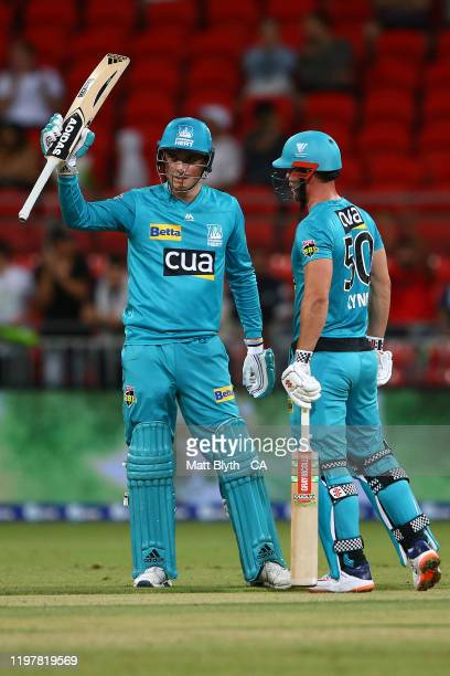 Tom Banton of the Heat celebrates his half century during the Big Bash League match between the Sydney Thunder and the Brisbane Heat at the Sydney...