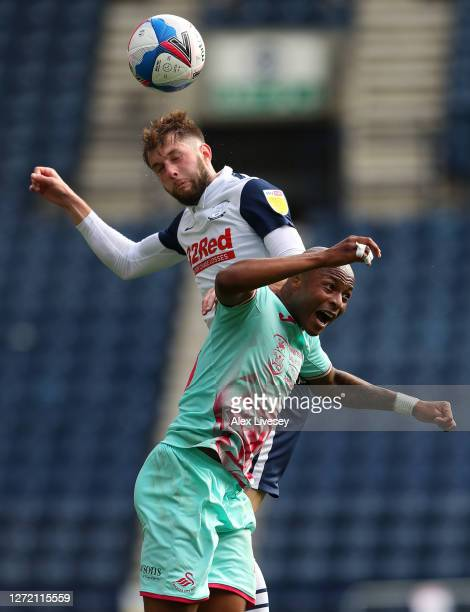 Tom Barkhuizen of Preston North End wins a header with Andre Ayew of Swansea City during the Sky Bet Championship match between Preston North End and...