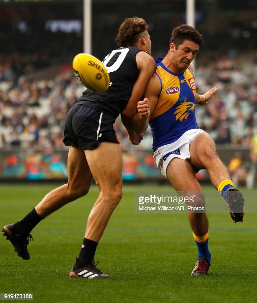 Tom Barrass of the Eagles and Charlie Curnow of the Blues in action during the 2018 AFL round five match between the Carlton Blues and the West Coast...