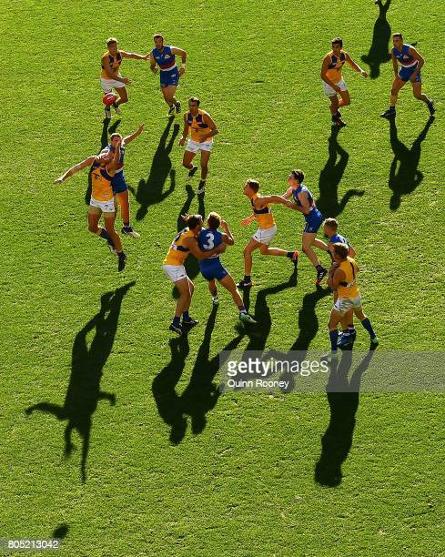 Tom Barrass of the Eagles and Jack Redpath of the Bulldogs compete for a mark during the round 15 AFL match between the Western Bulldogs and the West...