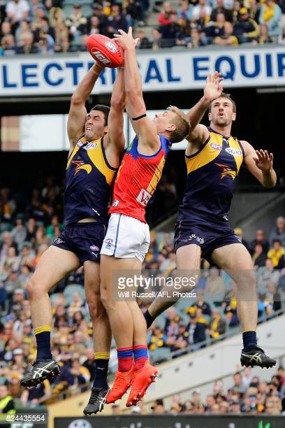 Tom Barrass of the Eagles and Jarrad Jansen of the Lions try for the mark during the round 19 AFL match between the West Coast Eagles and the...