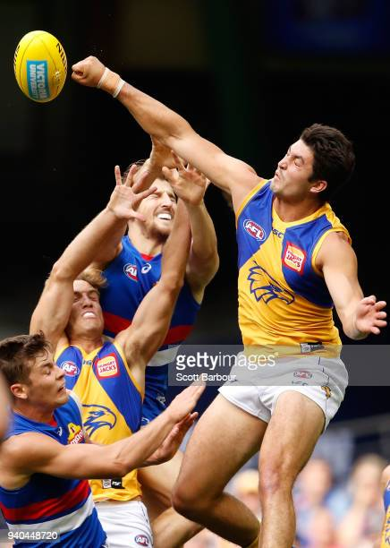 Tom Barrass of the Eagles and Marcus Bontempelli of the Bulldogs compete for the ball during the round two AFL match between the Western Bulldogs and...
