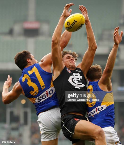 Tom Barrass of the Eagles Charlie Curnow of the Blues and Jack Redden of the Eagles compete for the ball during the 2018 AFL round five match between...
