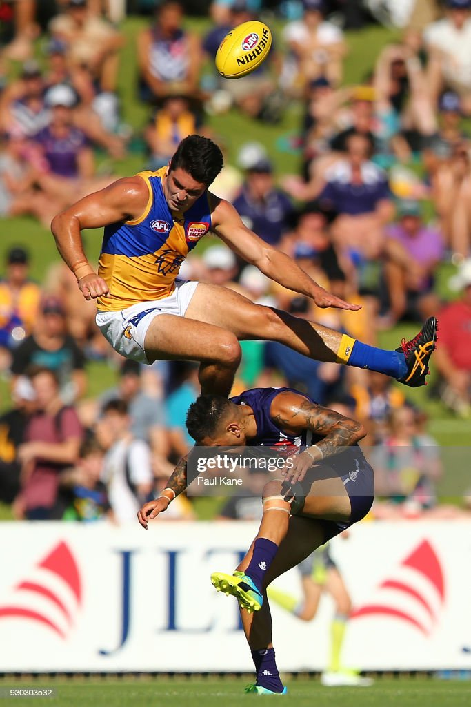 Tom Barrass of the Eagles crashes into Michael Walters of the Dockers during the JLT Community Series AFL match between the Fremantle Dockers and the West Coast Eagles at HBF Arena on March 11, 2018 in Perth, Australia.