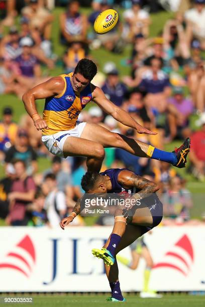 Tom Barrass of the Eagles crashes into Michael Walters of the Dockers during the JLT Community Series AFL match between the Fremantle Dockers and the...