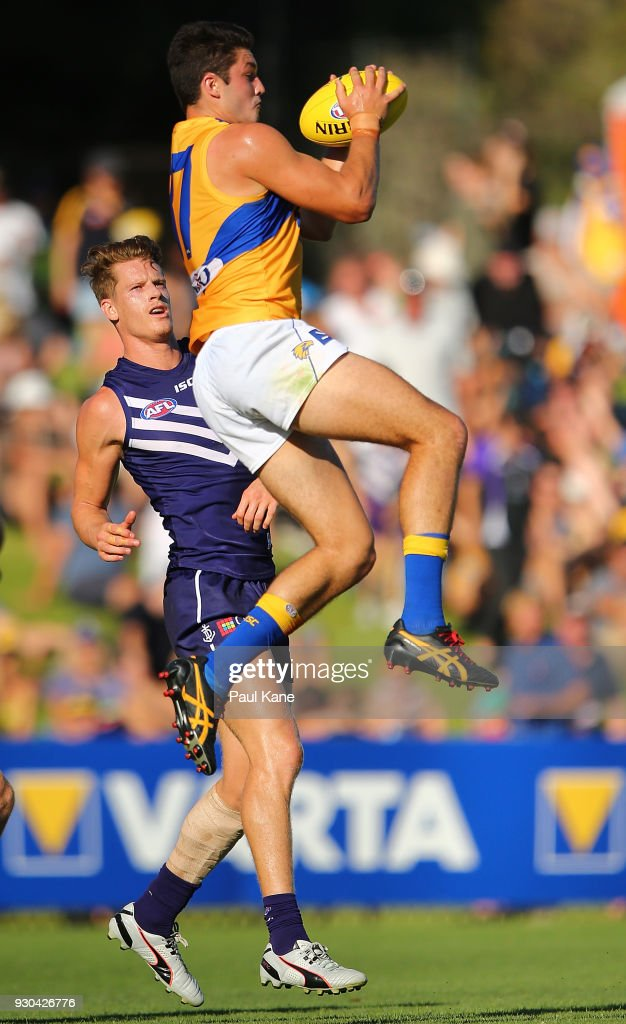 Tom Barrass of the Eagles marks the ball during the JLT Community Series AFL match between the Fremantle Dockers and the West Coast Eagles at HBF Arena on March 11, 2018 in Perth, Australia.