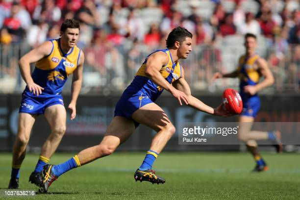 Tom Barrass of the Eagles runs onto the ball during the AFL Preliminary Final match between the West Coast Eagles and the Melbourne Demons on...