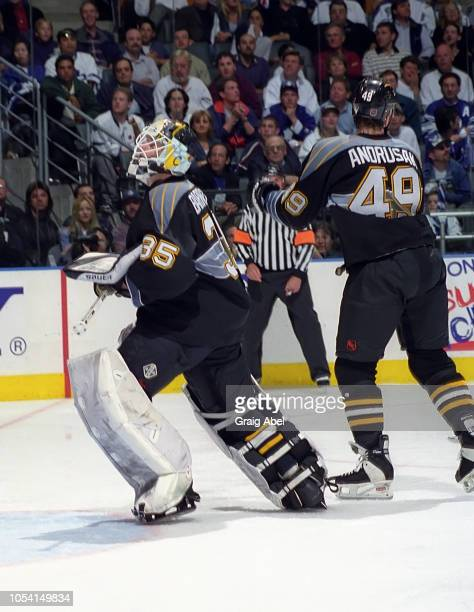 Tom Barrasso and Greg Andrusak of the Pittsburgh Penguins skates against the Toronto Maple Leafs during the 1999 Quarter Finals of the NHL playoff...
