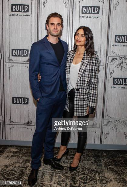 Tom Bateman and Julia Jones pose for photos before talking about their movie 'Cold Pursuit' at Build Studio on February 05 2019 in New York City