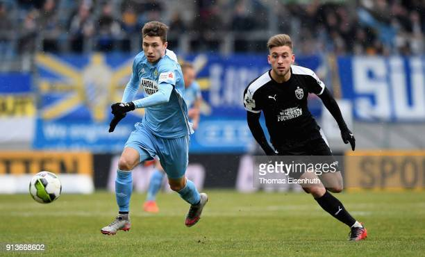 Tom Baumgart of Chemnitz is challenged by Dennis Slamar of Jena during the 3 Liga match between Chemnitzer FC and FC Carl Zeiss Jena at community4you...