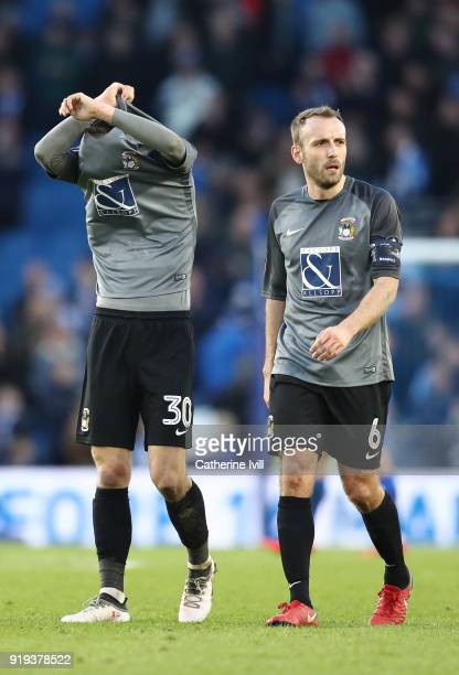 Tom Bayliss and Liam Kelly of Coventry City leave the pitch following the The Emirates FA Cup Fifth Round between Brighton and Hove Albion v Coventry...