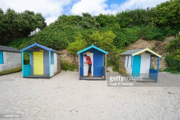 Tom beach hut Manager at Swanpool Beach checks the maintenance needs of the beach huts which returned to the beach with social distancing spacing...