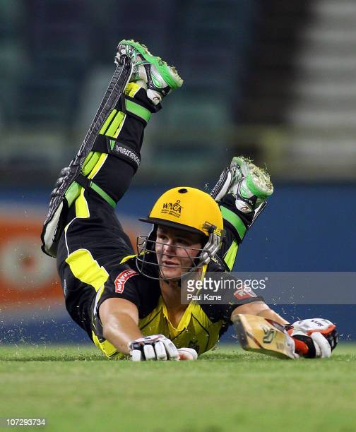 Tom Beaton of the Warriors dives to his crease during the Ryobi One Day Cup match between the Western Australia Warriors and the Queensland Bulls at...