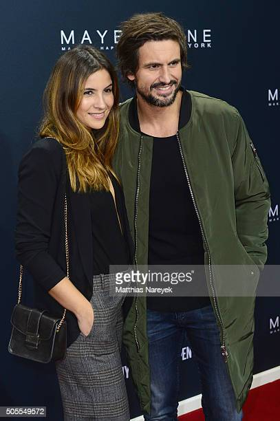 Tom Beck and Chryssanthi Kavazi attend the 'The Power Of Colors MAYBELLINE New York MakeUp Runway' show during the MercedesBenz Fashion Week Berlin...