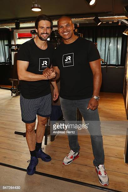 Tom Beck and Pierre Geisensetter pose for photographers at John Reed Fitness on July 14 2016 in Bonn Germany John Reed Fitness launches today their...