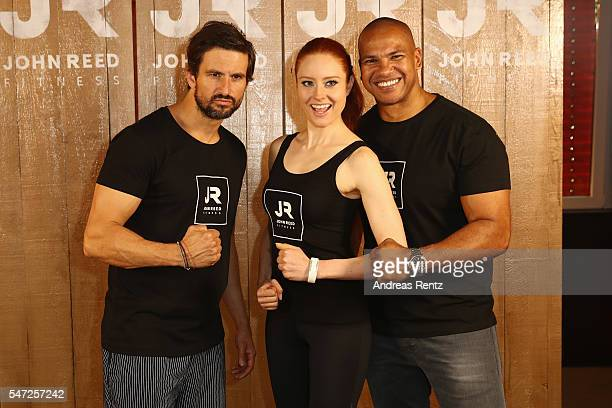 Tom Beck Barbara Meier and Pierre Geisensetter pose for photographers at John Reed Fitness on July 14 2016 in Bonn Germany John Reed Fitness launches...